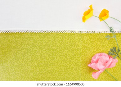 Textile background with pink and yellow wildflowers. Copy space and shot from above.
