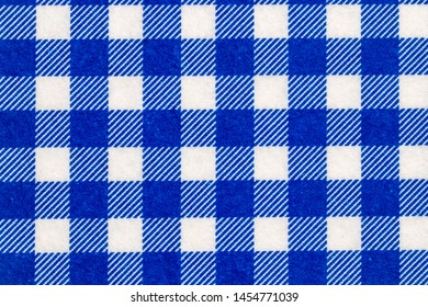 Textile background texture. Top view of details of a empty blue and white checkered kitchen cloth, textile, tablecloth or napkin. Template for food and product display montage. Macro.