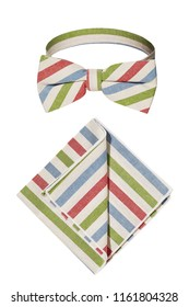 A textile bow tie and pocket square isolated over a white background. The neckwear pre-tied in a classic butterfly shape. Elegant accessories for men's formal suits.  Blue, red, green, white stripes.