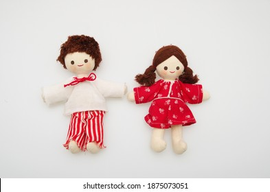 Textile doll toys, a boy and a girl isolated on white