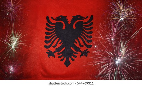 Textile flag of Albania with firework grunge concept seamless close up with wind waves in the real fabric