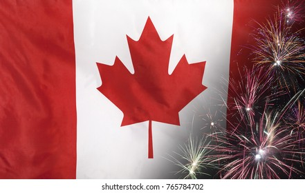 Textile flag of Canada with firework close up with wind waves in the real fabric