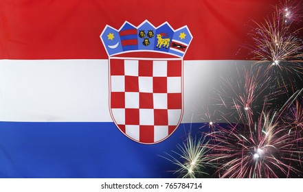 Textile flag of Croatia with firework close up with wind waves in the real fabric