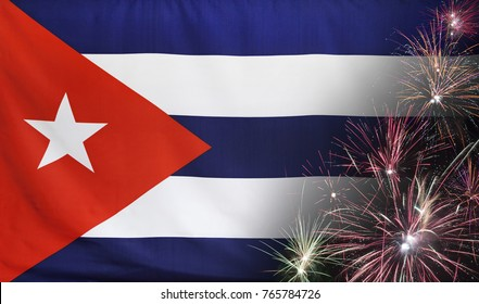 Textile flag of Cuba with firework close up with wind waves in the real fabric