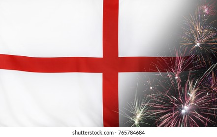Textile flag of England with firework close up with wind waves in the real fabric