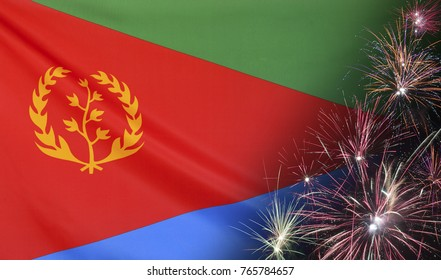 Textile flag of Eritrea with firework close up with wind waves in the real fabric