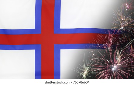 Textile flag of Faroe Islands with firework close up with wind waves in the real fabric