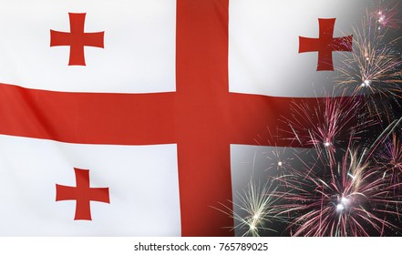Textile flag of Georgia with firework close up with wind waves in the real fabric