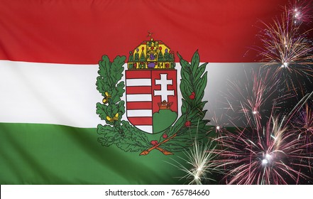 Textile flag of Hungary Coat of Arms with firework close up with wind waves in the real fabric