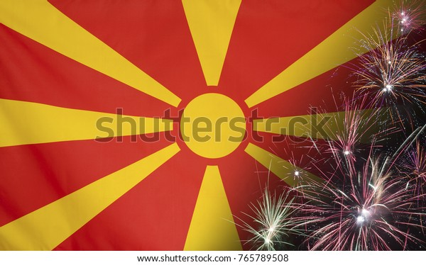 Textile flag of Macedonia with firework close up with wind waves in the real fabric