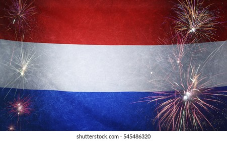 Textile flag of Netherlands with firework grunge concept seamless close up with wind waves in the real fabric