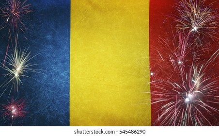 Textile flag of Romania with firework grunge concept seamless close up with wind waves in the real fabric