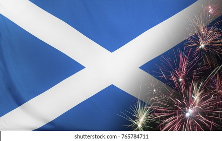 Textile flag of Scotland with firework close up with wind waves in the real fabric