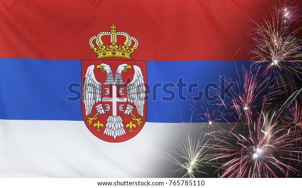 Textile flag of Serbia with firework close up with wind waves in the real fabric