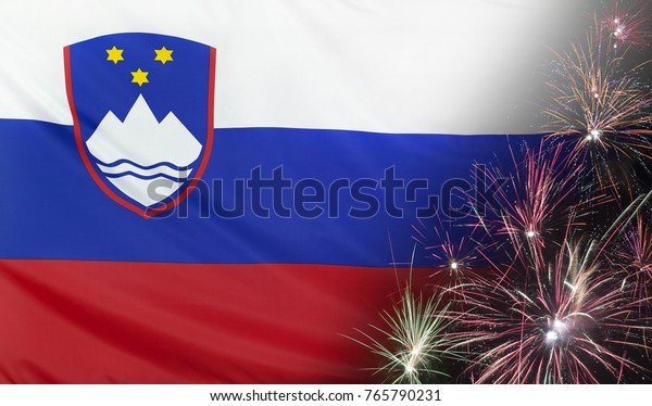 Textile flag of Slovenia with firework close up with wind waves in the real fabric