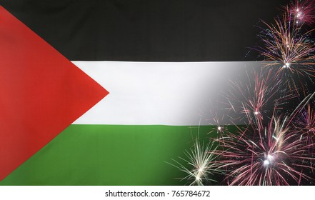 Textile flag of State of Palestine with firework close up with wind waves in the real fabric
