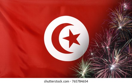 Textile flag of Tunisia with firework  close up with wind waves in the real fabric