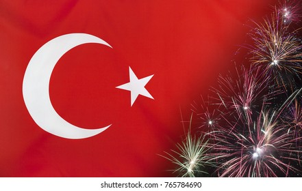 Textile flag of Turkey with firework close up with wind waves in the real fabric
