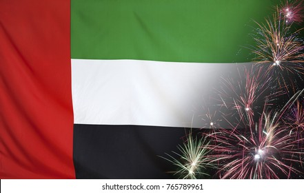 Textile flag of UAE with firework close up with wind waves in the real fabric