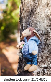 textile handmade sheep in blue jacket and jeans with flowers
