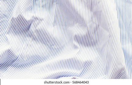 Textile, material, cotton, linen, crumpled, crease, crinkled, wrinkled, white, blue vertical stripes, shirt