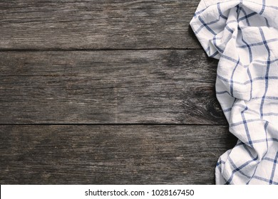 Textile on old wooden background with copy space for text. Food background, menu, lifestyle and holidays background mock up. Rustic wood textured backdrop