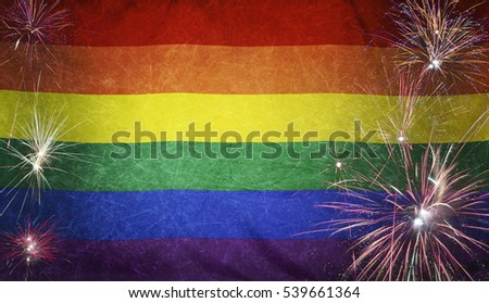 Textile Rainbow Flag with firework grunge concept seamless close up with wind waves in the real fabric
