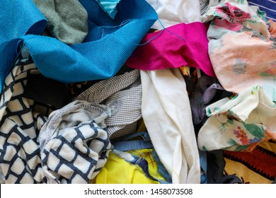 Textile ready to be recycled. Pile of old clothes in different colors.