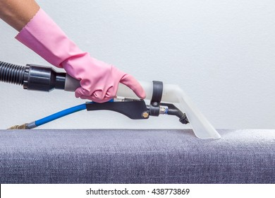 Textile sofa chemical cleaning with professionally extraction method. Upholstered furniture. Early spring cleaning or regular clean up.