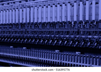 Textile spindles on the production line, closeup of photo