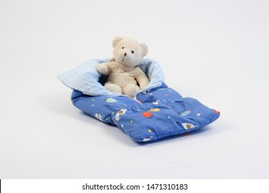 textiles for newborns in the photo Studio on a white background, the side of the pillow in a baby bed, blankets are transformed into envelopes for a walk, a cocoon for a comfortable and safe sleep of