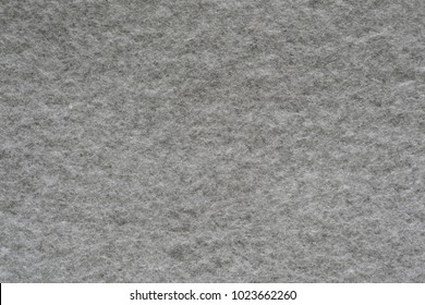 textural background or wallpaper of soft wadded fabric or textile material of gray color