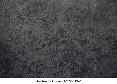 Textural gray background with the transition to black.View from above. Copy space.