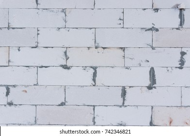 texture of AAC brick wall (Autoclaved Aerated Concrete Masonry Unit), unfinished brick wall, exposed brick wall