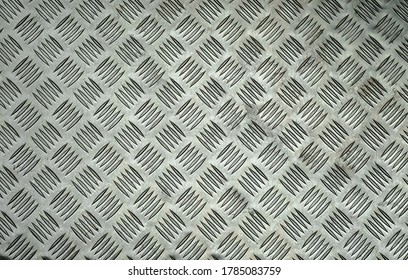 The texture of an aluminum plate with cuts and stripes.