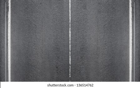 Texture of an asphalt road with marking lines