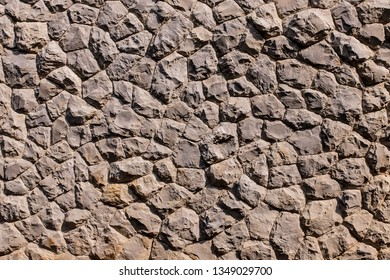 A texture backgound of rock wall with strong light of sun
