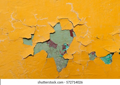 Texture background of bright yellow and blue peeling paint