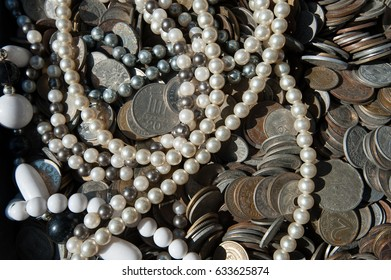 Texture background with coins and jewelry