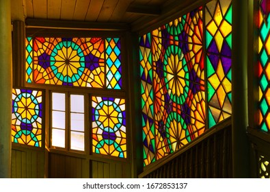 Texture background for design. Decorative color stained glass window. On the streets in Georgia in public places.