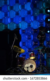 Texture background for design. Stage light and defocus and blur. Musical instruments stand on stage.