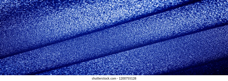 Texture, background, The fabric has a bright blue, aqua, azure color with a metallic silver thread. These fabrics are ideal for any project, wallpaper, all design solutions. and many uses of ships.