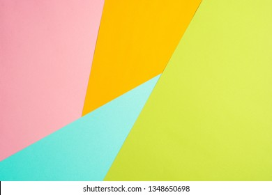 texture background of fashionable pastel color with top view, minimal concept, flat lay: blue, orange, green and pink