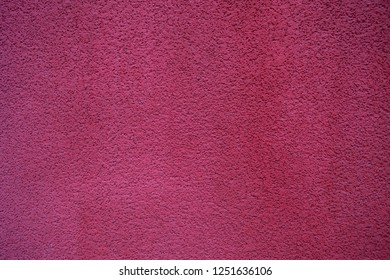 Texture background. Granular red painted wall