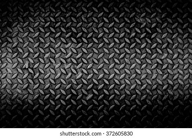 texture background of grungy old weathered  metal diamond plate with scratch and dirty in dark tone