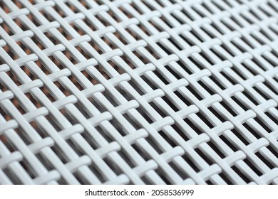 Texture background lattice: white plastic grating, grid or wicker grate in perspective. Venting, ventilation