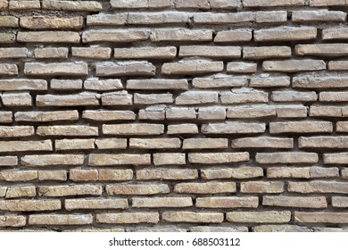 Texture background masonry of old brick in Uzbekistan