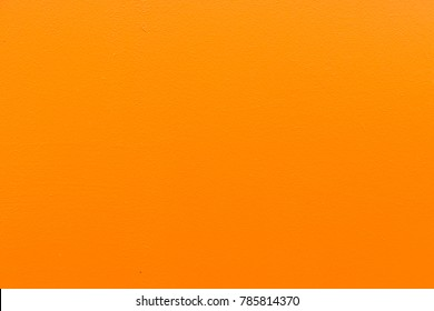 Texture Background of Orange or Light Brown Rough Cement Building Wall