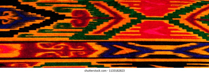 Texture, background, pattern. Cloth Uzbek motifs. Indian fabric. Maly rug for Muslims