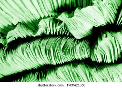Texture, background, pattern, Fabric silk pleated green. This beautiful quality fabric has an excellent corrugated wrinkled texture, drape and semi-curved. Ideal for making your design